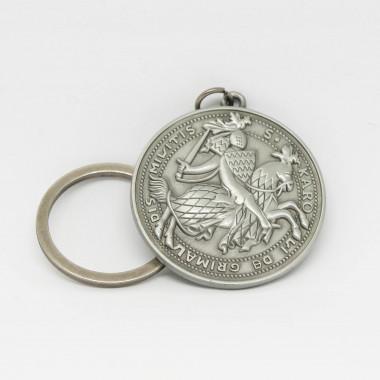 Porte-clés rond en métal avec sur une face le blason des Sites Historiques Grimaldi de Monaco.